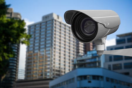 CCTV camera against beautiful cityscape against clear sky
