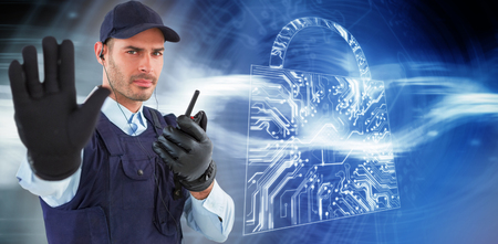 Confident security officer making stop gesture against virus background Stock Photo