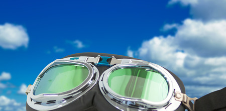 quadratic: Aviator goggles on white background against scenic view of blue sky