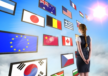 dreariness: Digital composite of panel with flags in the sky. Business woman with plait Stock Photo