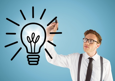 Digital composite of Business man drawing lightbulb doodle with flare against blue background