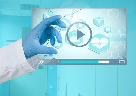 closet door: Digital composite of Doctors Hand touching Medical Video Player App Interface
