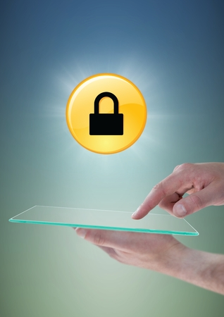 Digital composite of Hands with glass device and yellow lock graphic with flare against blue green background Stock Photo