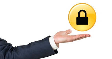 Digital composite of Business man hand with black and yellow lock graphic Stock Photo