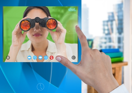 Digital composite of Hand touching Social Video Chat App Interface with woman holding binoculars