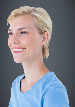 computer animation: Digital composite of Close up profile of woman smiling against grey background Stock Photo