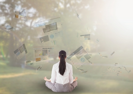Digital composite of panels with websites flaying and business woman meditating in the park