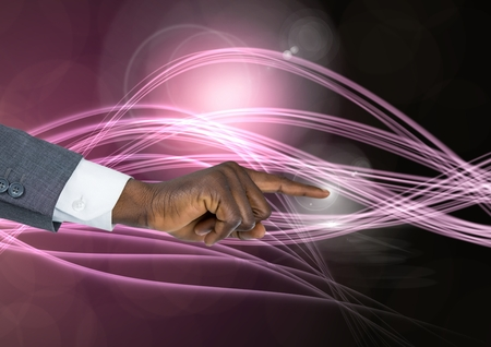 Digital composite of Hand Touching  air of  of magical atmospheric curves Stock Photo