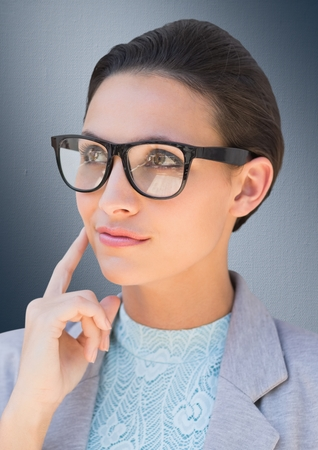 beaming: Digital composite of Close up of business woman with glasses thinking against navy background