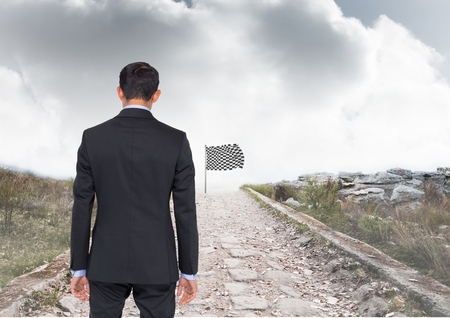 formula one: Digital composite of businessman in a road going to catch the checker flag