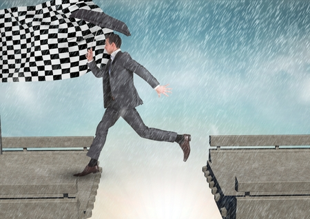 Digital composite of businessman with umbrella arraiving to the checker flag in a  broken bridge Stock Photo