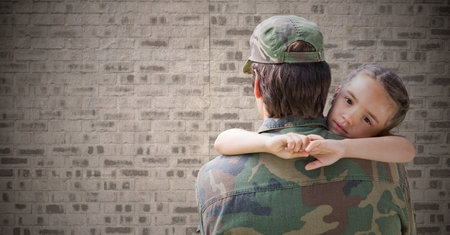 cross legged: Digital composite of Back of soldier with daughter against brown brick wall Stock Photo