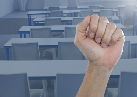 tight body: Digital composite of Hand in fist in classroom