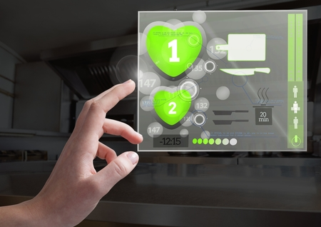 time sensitive: Digital composite of Hand touching Cooking App Interface Stock Photo