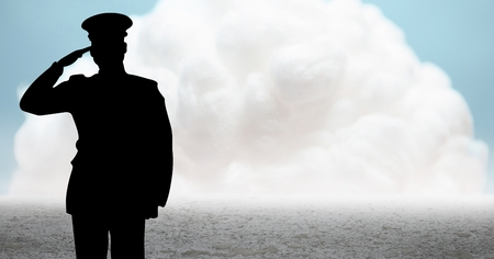 solider: Digital composite of Captain silhouette saluting against cloud and ground Stock Photo