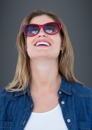 Digital composite of Close up of woman in sunglasses against grey background