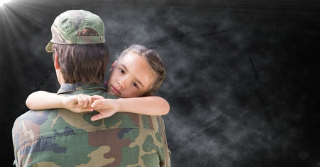 Digital composite of Back of soldier with daughter against black grunge background with flare