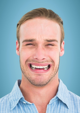 Digital composite of Man crying against blue background Stock Photo