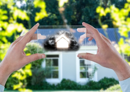 Digital composite of house with cloud on futuristic device in front of a house