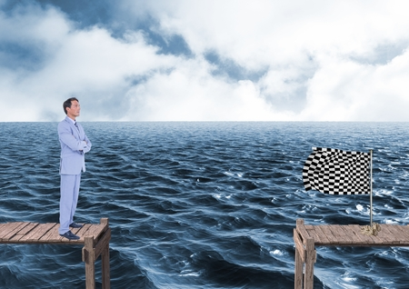 Digital composite of businessman with his hands folded looking to the checker flag in a quay Stock Photo