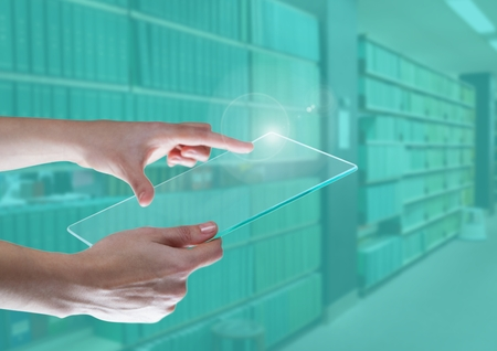 flooring: Digital composite of Hand touching a tablet in green library