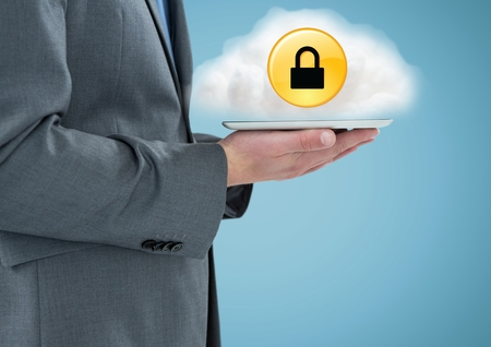 Digital composite of Business man mid section with tablet and cloud with yellow lock icon