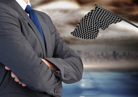 Digital composite of businessman with his hands folded with checker flag  and the city behind him Stock Photo