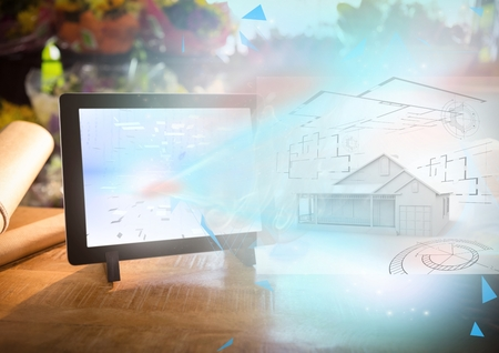 abode: Digital composite of house 3D blueprint going out from tablet Stock Photo
