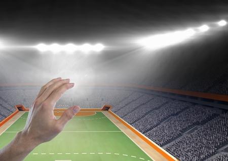 terrain de handball: Digital composite of Hand touching  air with handball stadium Banque d'images
