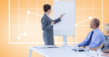 meet up: Digital composite of Businesswoman giving presentation to colleagues against graph
