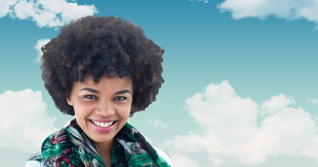 Digital composite of Smiling woman with curly hair against sky Stock Photo