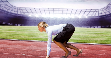 Digital composite of Side view of businesswoman on running tracks Stock Photo