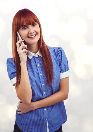 Digital composite of Redhead businesswoman using smart phone