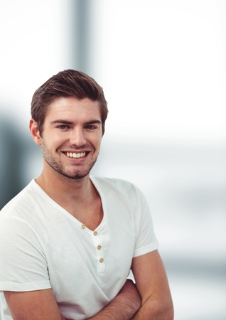 uneasy: Digital composite of Young man with arms crossed smiling