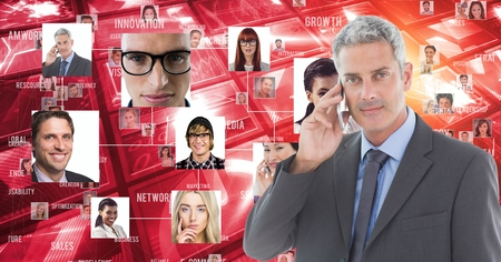 Digital composite of Digitally generated image of businessman using smart phone against portraits Stock Photo