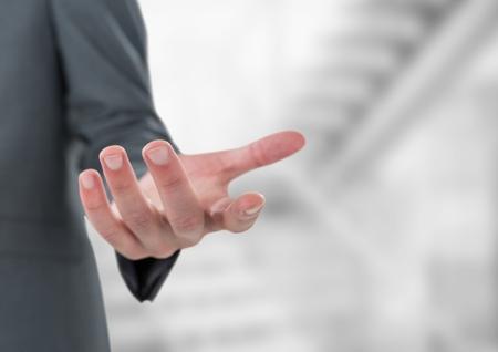 futuristic interior: Digital composite of Cropped image of businessman gesturing