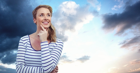 Digital composite of Thoughtful woman looking away against sky