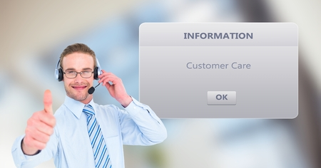 Digital composite of Customer support executive showing thumbs up by dialog box Reklamní fotografie