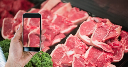 Digital composite of Hand photographing meat through smart phone in grocery store