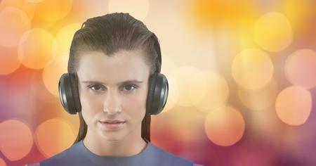 Digital composite of Female hipster listening to music against bokeh Stock Photo