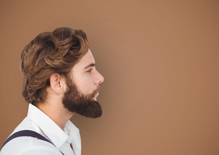 Digital composite of Side view of hipster with beard over brown background