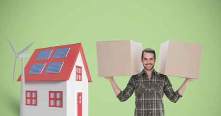Digital composite of Portrait of delivery man carrying cardboard boxes by house and windmill