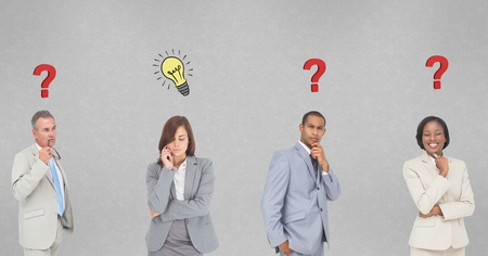 Digital composite of Thoughtful business people with question marks and light bulb marks on wall