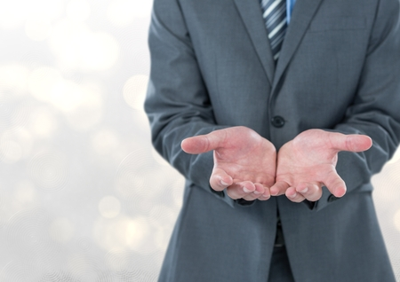introducing: Digital composite of Midsection of businessman holding invisible product
