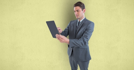 man holding transparent: Digital composite of Businessman holding tablet PC over colored background Stock Photo
