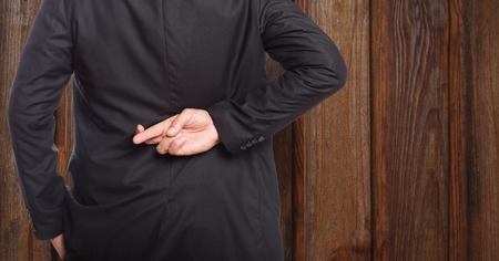 Digital composite of Midsection rear view of businessman crossing fingers against wood
