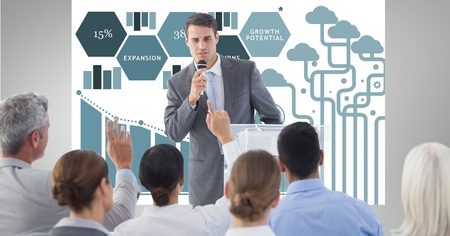 using tablet: Digital composite of Businessman giving presentation to colleagues with graphics in background