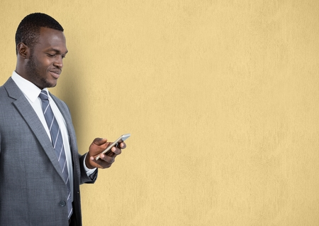 introducing: Digital composite of Businessman using mobile phone over beige background