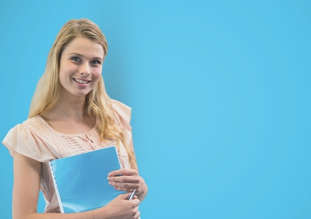 Digital composite of Portrait of woman holding book against blue background