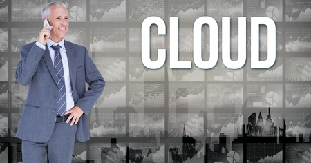 Digital composite of Businessman using mobile phone by cloud text